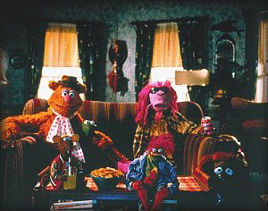 The Muppets watch tv in their boarding house